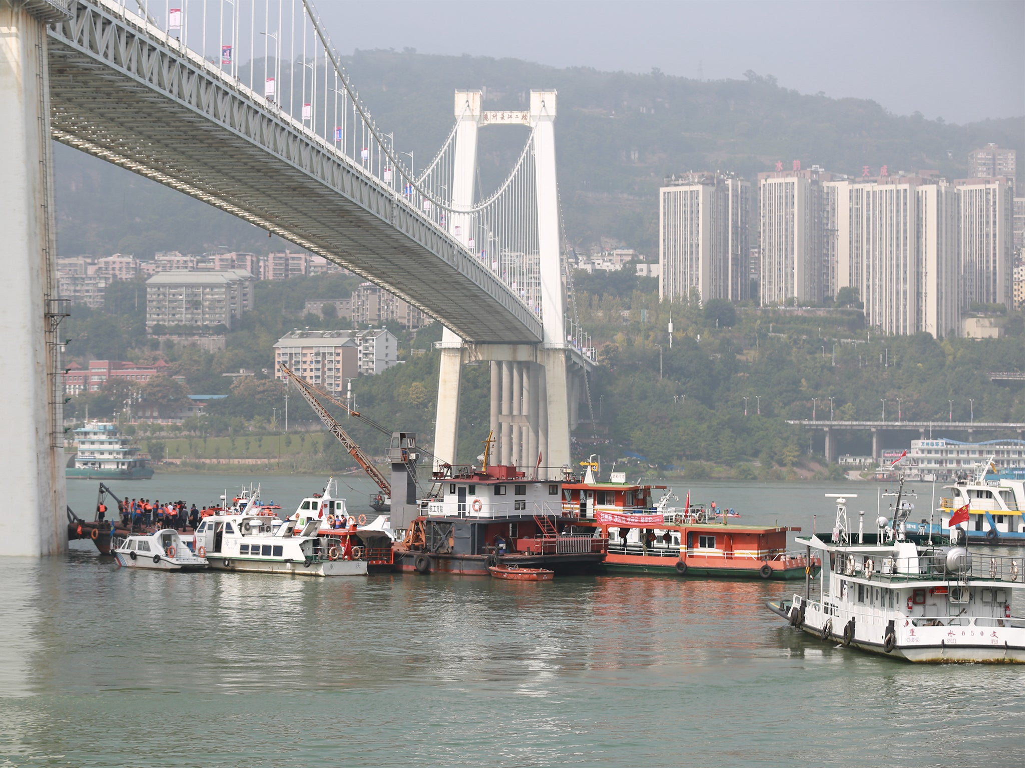 Bus plunged off bridge in China after passenger fought with
