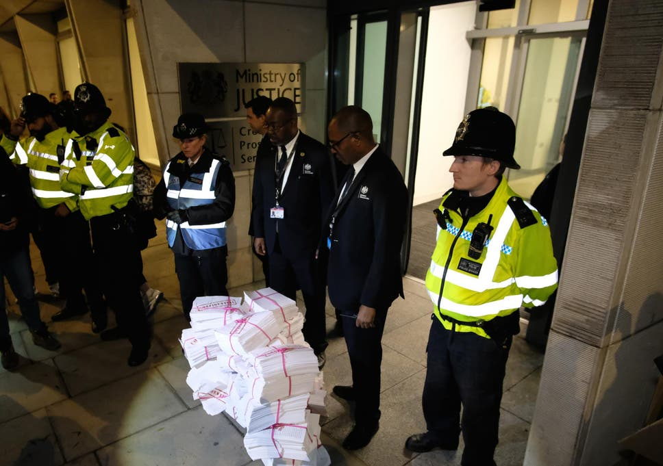 Protesters dumped documents representing rape victims' phone data outside the CPS's offices in November