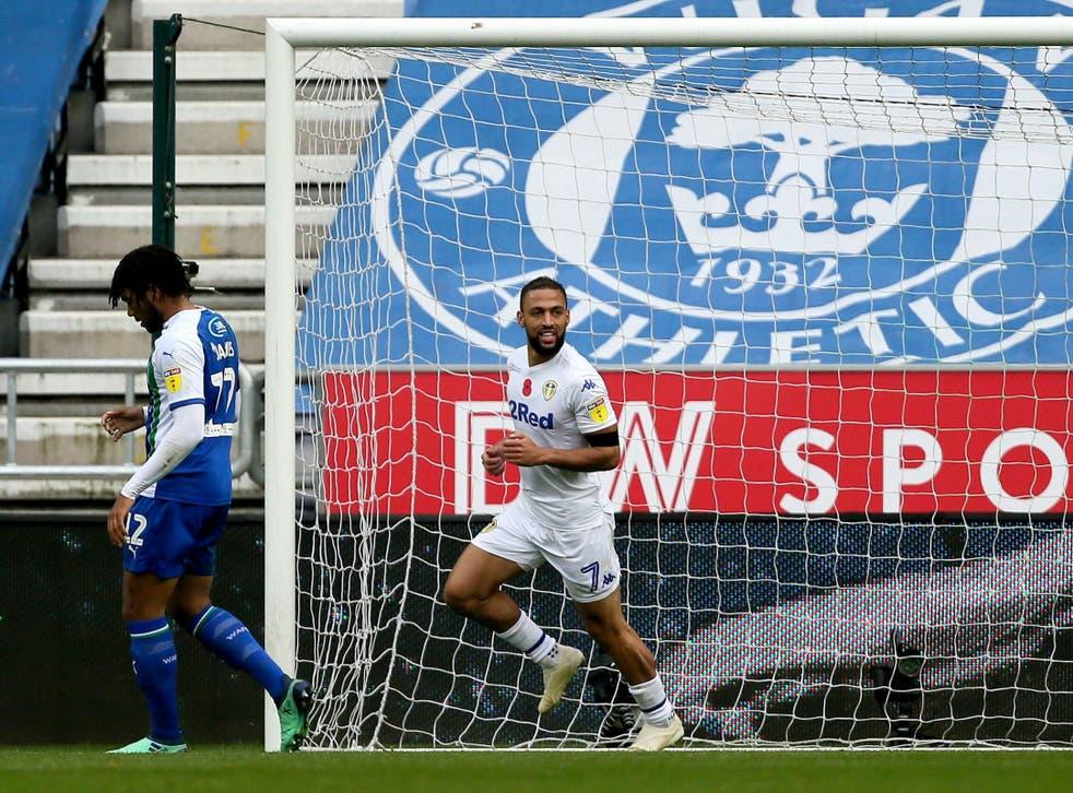 Kemar Roofe celebrates scoring Leeds' second goal against Wigan