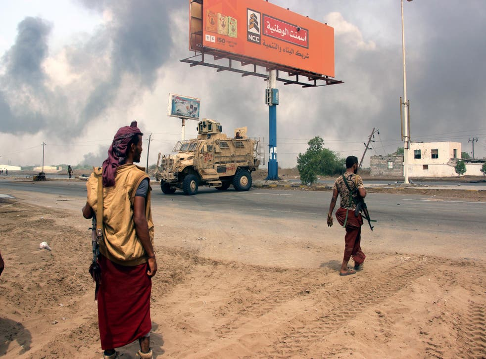 Yemeni government forces patrol near the port city of Hodeidah, Yemen, ahead of an offensive