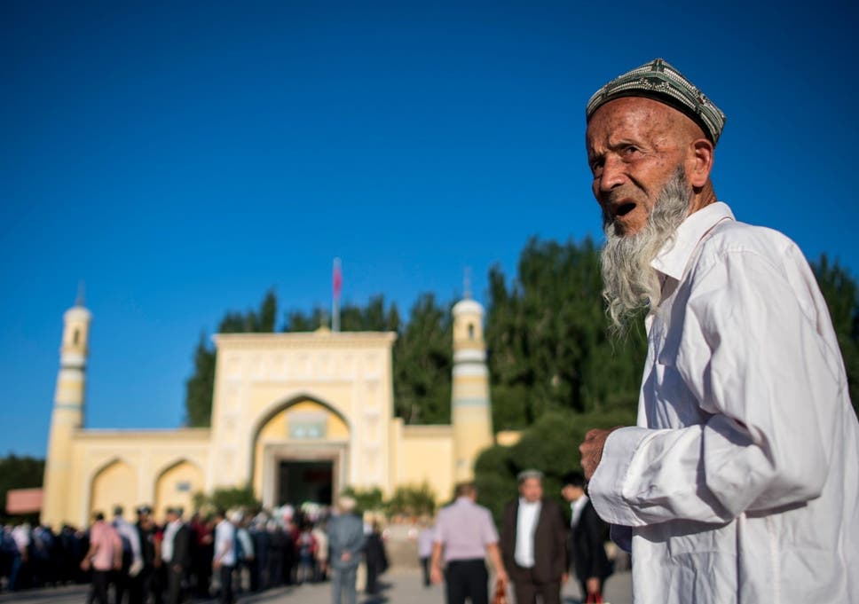 A man arriving in front of the Id Kah Mosque for the morning prayer on Eid al-Fitr in the old town of Kashgar in China's Xinjiang Uighur Autonomus Region