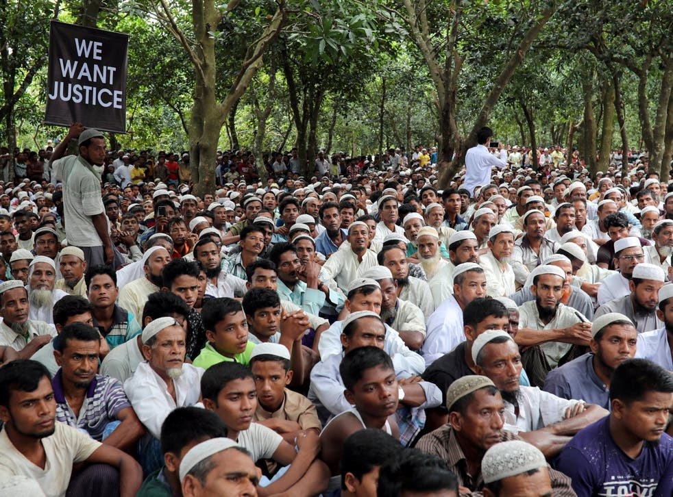 Rohingya refugees take part in a protest marking the one year anniversary of their exodus from Myanmar in Cox's Bazar, Bangladesh