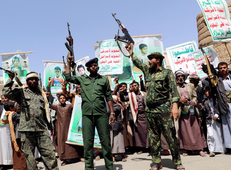Houthi followers demonstrate to show rejection of an offer by the Saudi-led coalition to pay compensation for victims of an air strike in Saada, Yemen