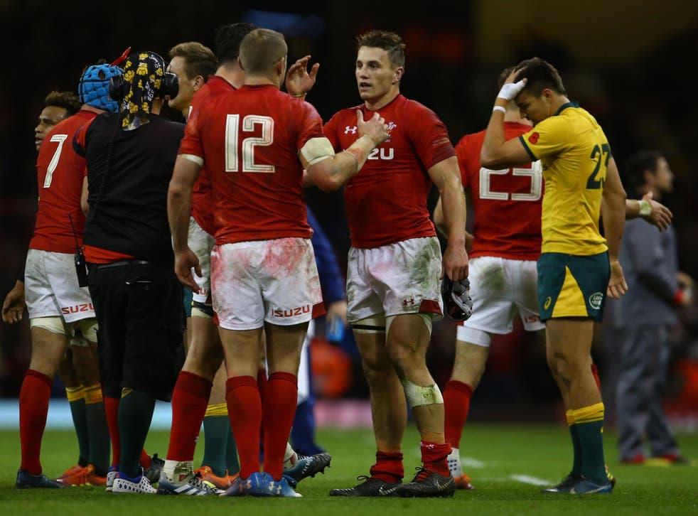 Wales celebrate after securing victory at the Principality Stadium