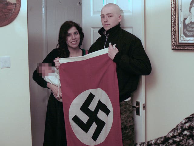 Adam Thomas and Claudia Patatas posed for pictures with their son alongside Nazi paraphernalia