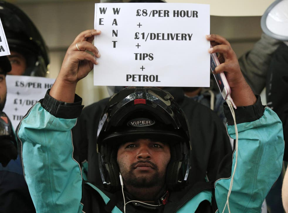 A Deliveroo driver protesting over rates of pay