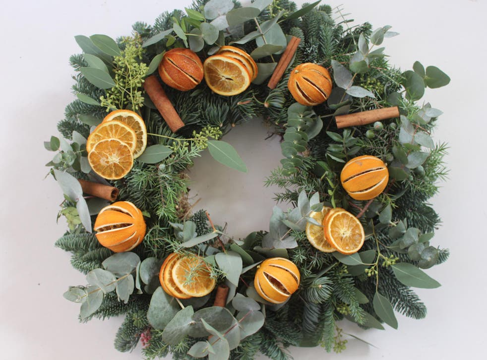 This Pod & Pip wreath is decorated with dried oranges, fir cones and eucalyptus