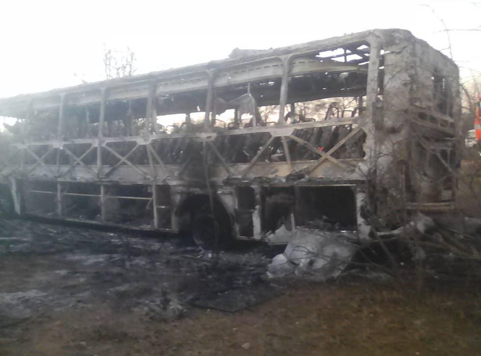 Remains of a bus involved in an accident which killed 40 people in Zimbabwe