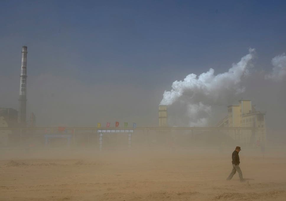 A coal plant partly obscured by a dust storm in China's Ningxia Hui autonomous region; the country is one of the worst offenders when it comes to emissions