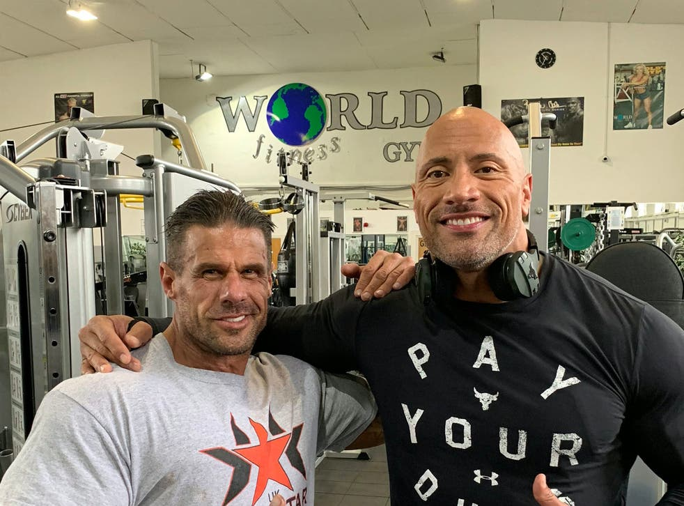 Dwayne 'The Rock' Johnson posing with Craie Carrera, owner of World Fitness Gym in Doncaster