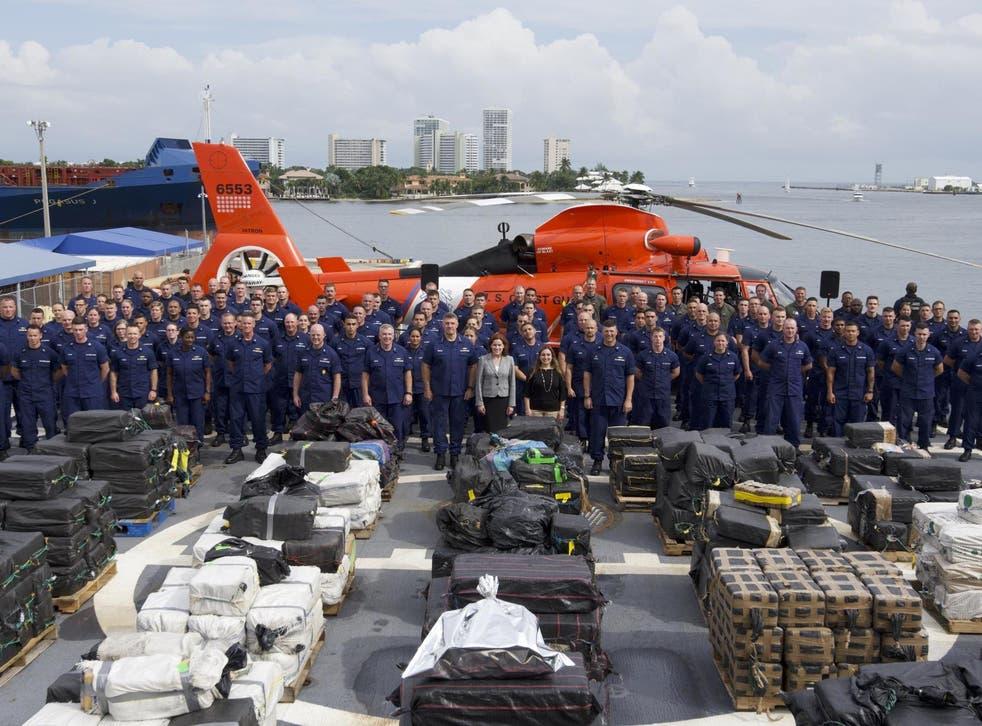 Coast guard officials show off interdicted cocaine