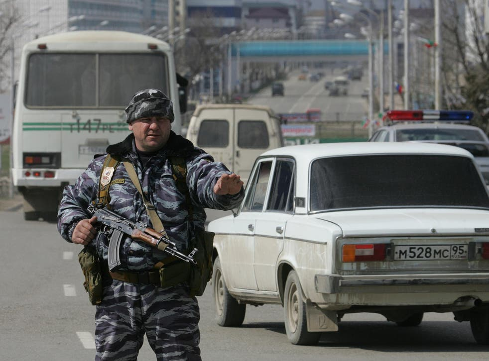 A Chechen policeman stands guard in Grozny