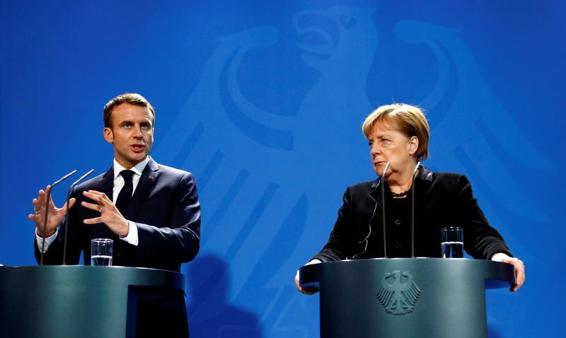 Macron says Europe must 'take more responsibility for its defence' while visiting Berlin