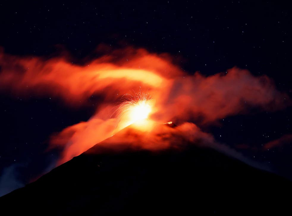 Volcano of Fire mount spews hot ashes and lava, as seen from Alotenango, Guatemala, on 18 November 2018