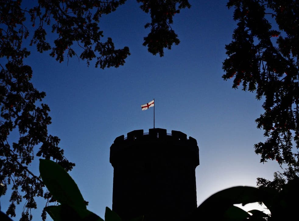 An early morning view of Warwick Castle, still black, just reappearing, yet the flag shines as if it had done so the whole night through, as if it had always been this way: a beacon of light in a world of darkness