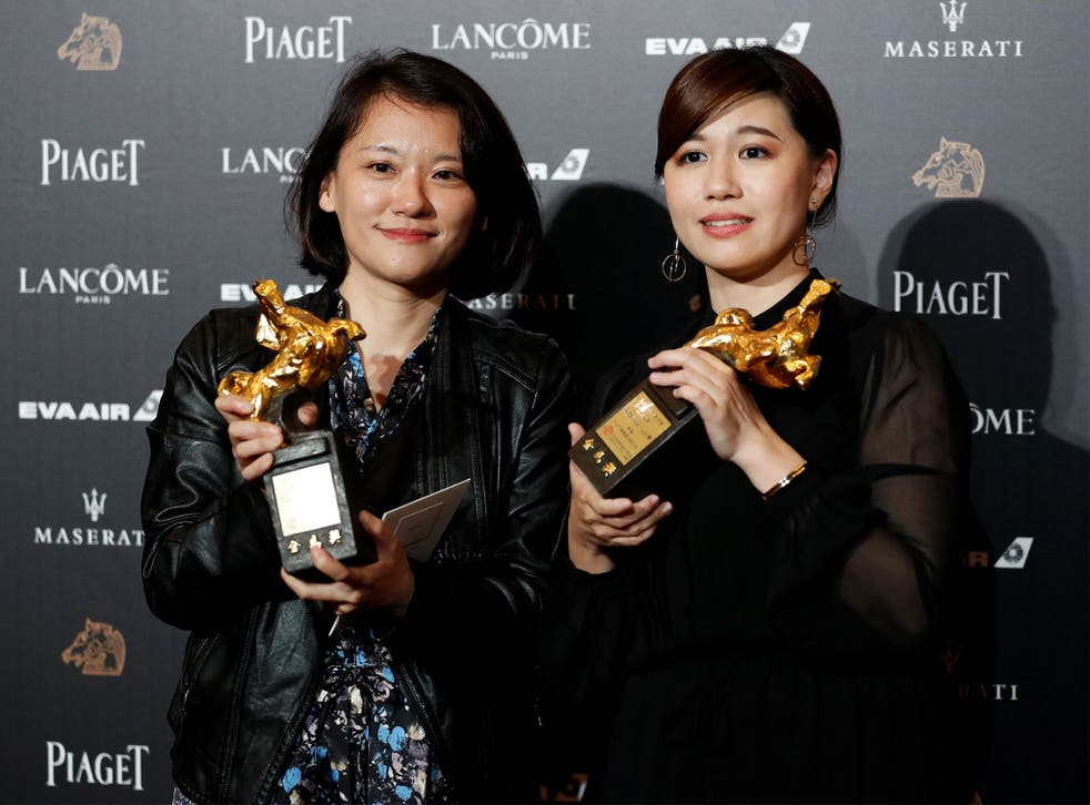 Fu Yue (right) poses with her Golden Horse award after delivering a controversial acceptance speech promoting Taiwanese independence