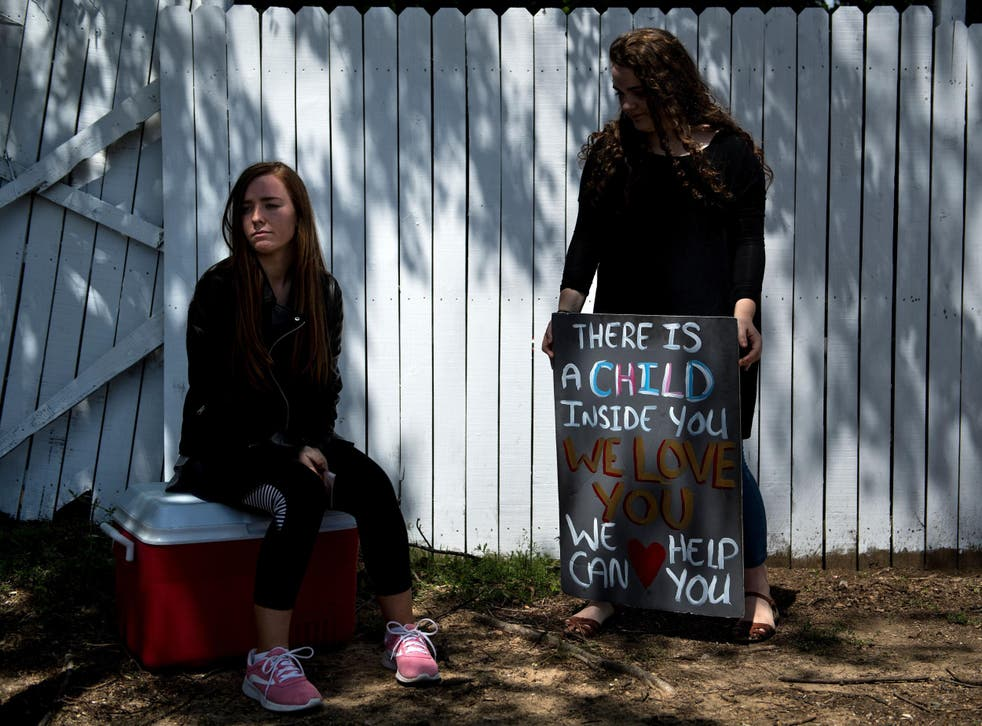 Pro-life activists wait for patients to arrive outside the Jackson Women's Health Organisation, the last abortion clinic in Mississippi.