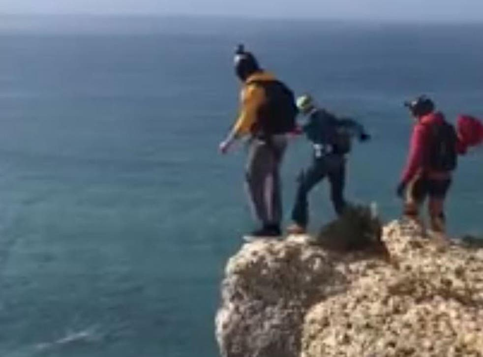 Dominic Loyen (centre, in blue) seconds before his fatal jump