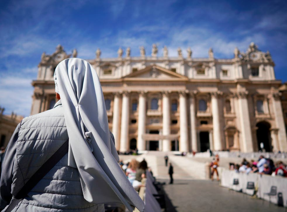 A nun waits for the arrival of Pope Francis for his weekly general audience, in St Peter's Square at the Vatican