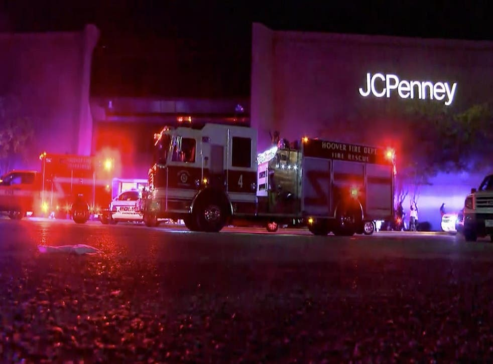 First responders outside the mall after the shooting. Photo via AP