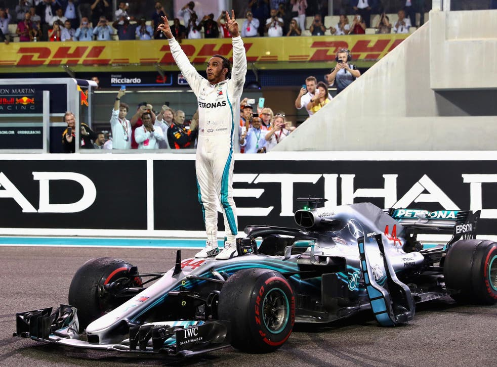 The world champion celebrates his final victory of the year