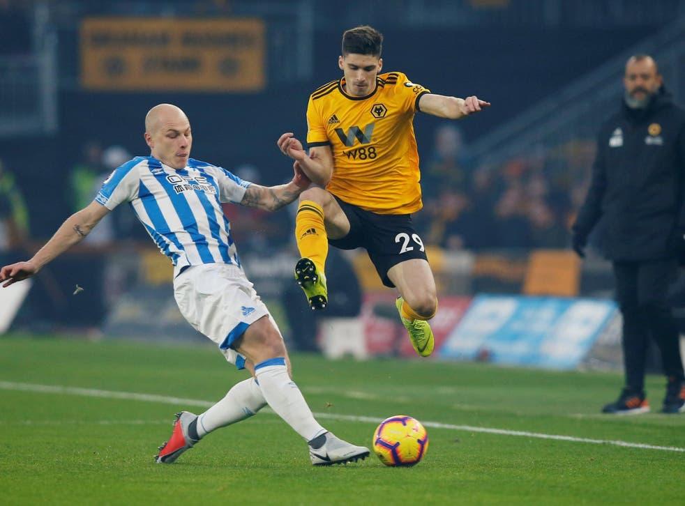 Aaron Mooy gets across to challenge Wolves' Ruben Vinagre