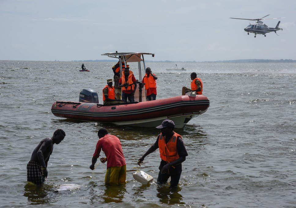 Rescuers search for victims the day after the cruise boat capsized on Lake Victoria