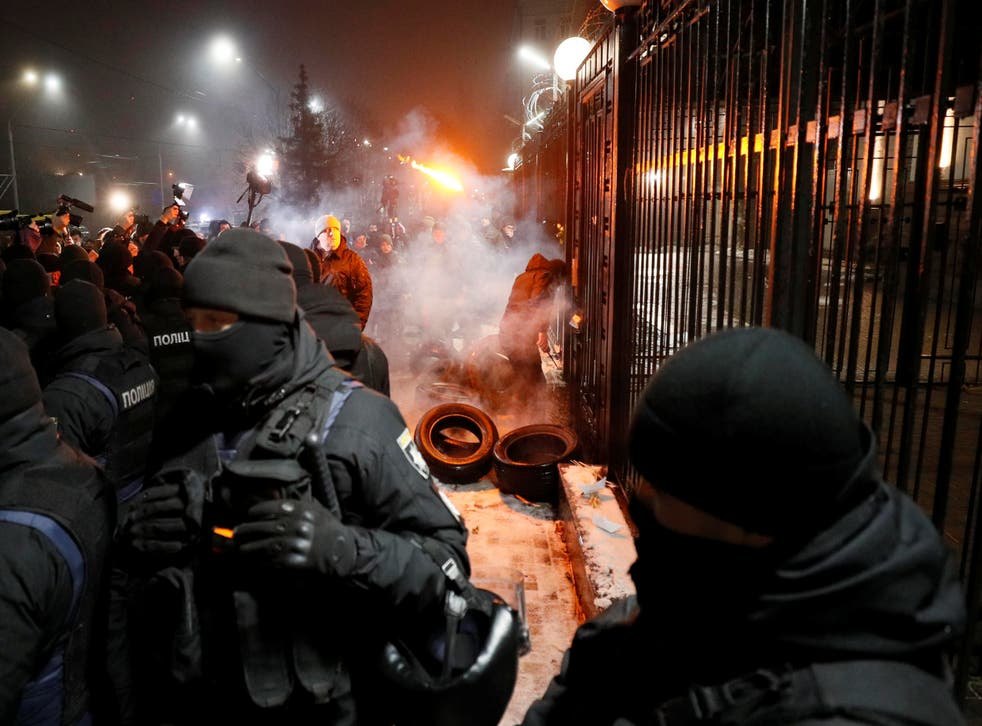 Protesters set fires outside the Russian embassy in Kiev after the seizure of three Ukrainian navy ships