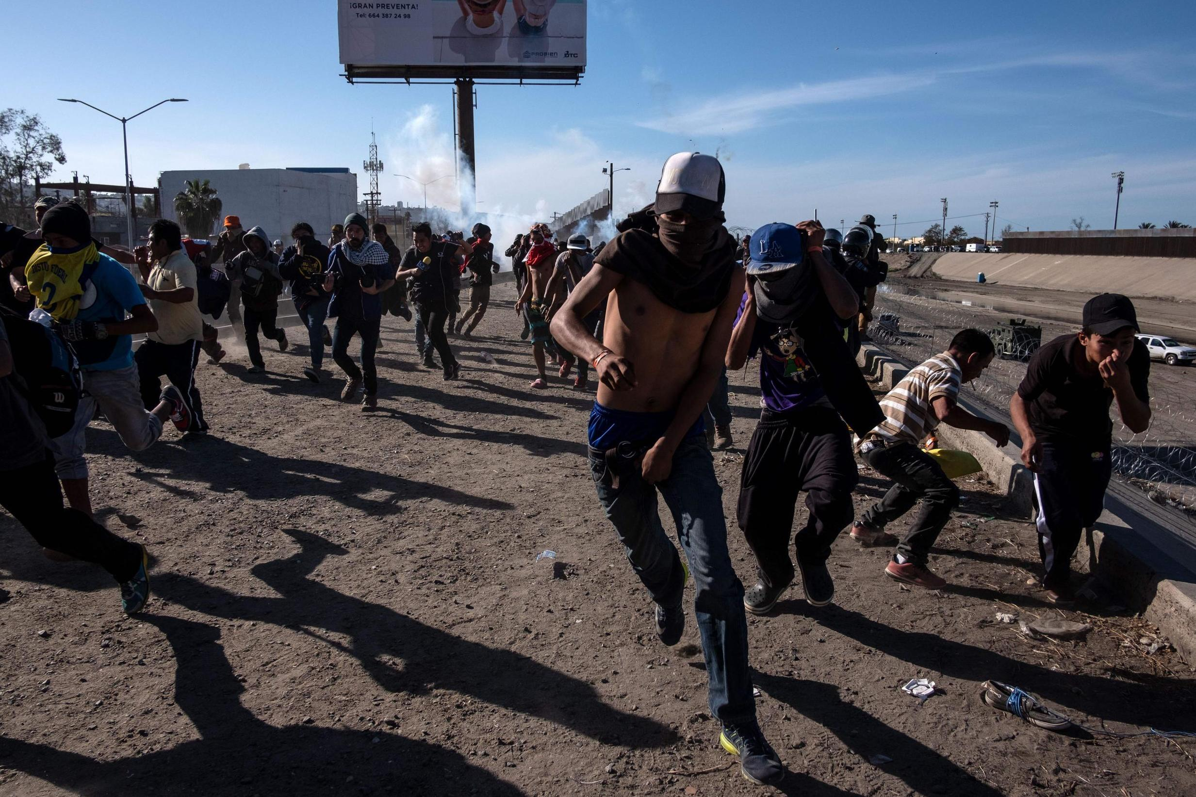 Pepper spray used on migrants 'safe enough to put on nachos and eat', former US border patrol chief claims