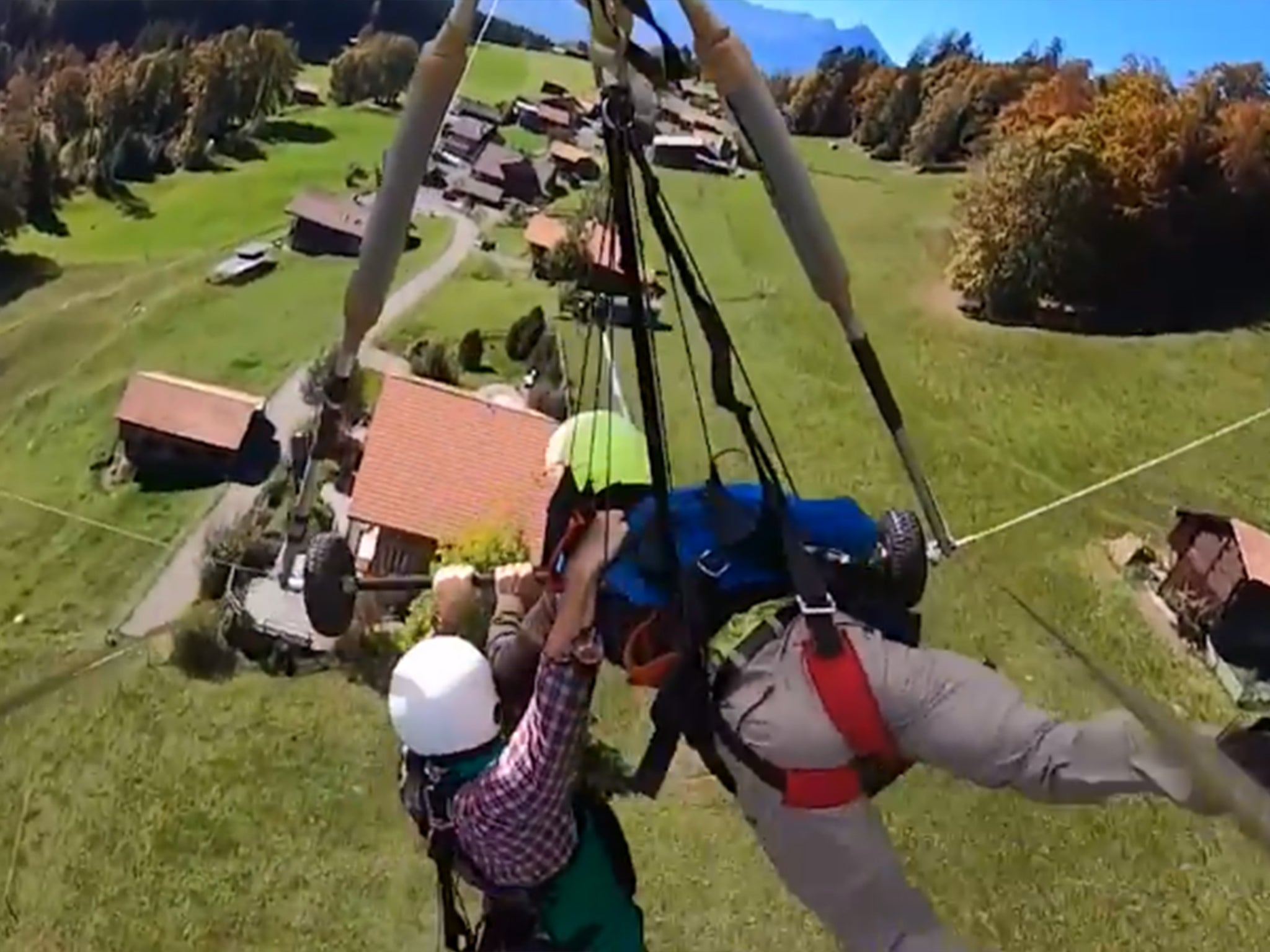 Hang glider desperately clings on after pilot forgets to attach him