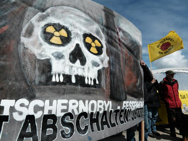 French and German anti-nuclear activists pictured on 24 April 2016 during a commemoration of the Chernobyl nuclear disaster and to protest against the nuclear power plant in Fessenheim, France, the country's oldest reactor (Frederick Florin/
