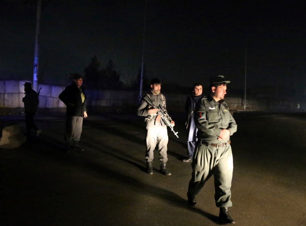 Security forces block the roads at the site of a suicide bomb attack in Kabul, Afghanistan