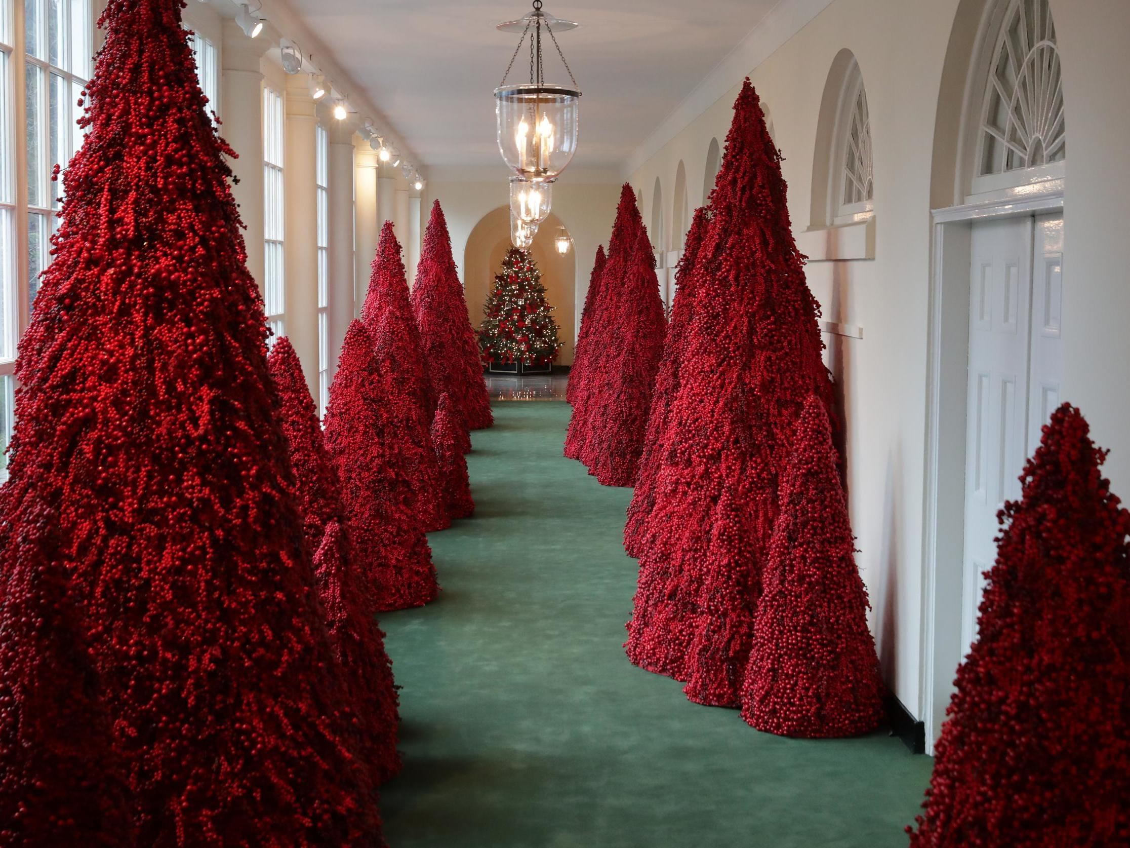 ae0b14dd1104 Melania Trump lashes out at media for mocking her blood-red Christmas trees  at White House | The Independent