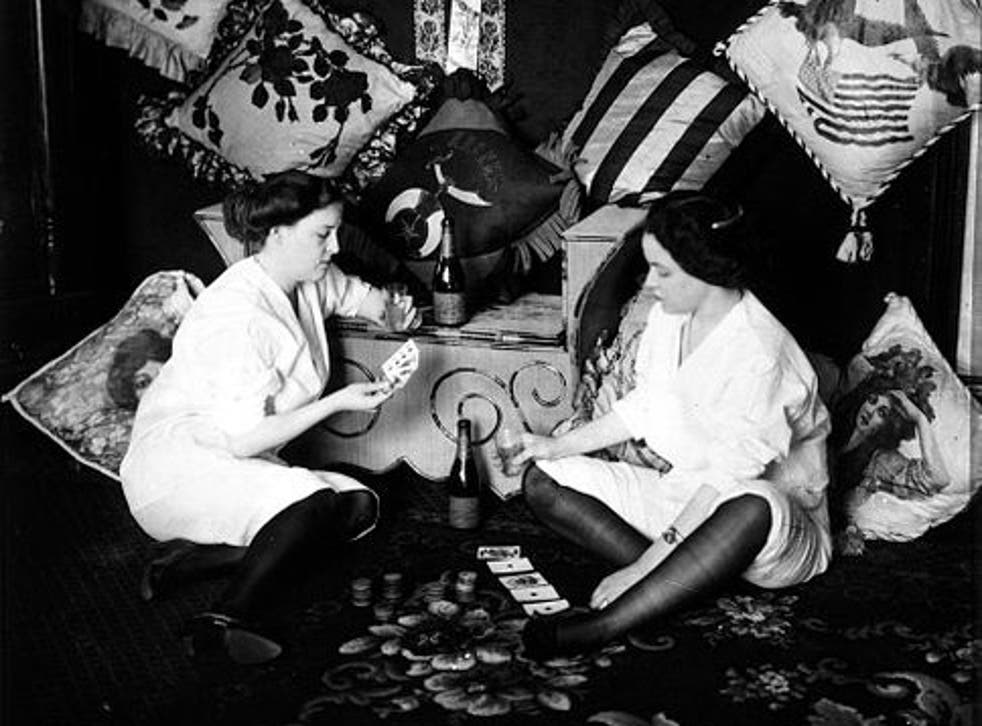 Two women play cards in Storyville, circa 1912. After two decades of lucrative operations, the area's brothels were forced to close as a result of intense political pressure exerted by the US military – especially the Navy