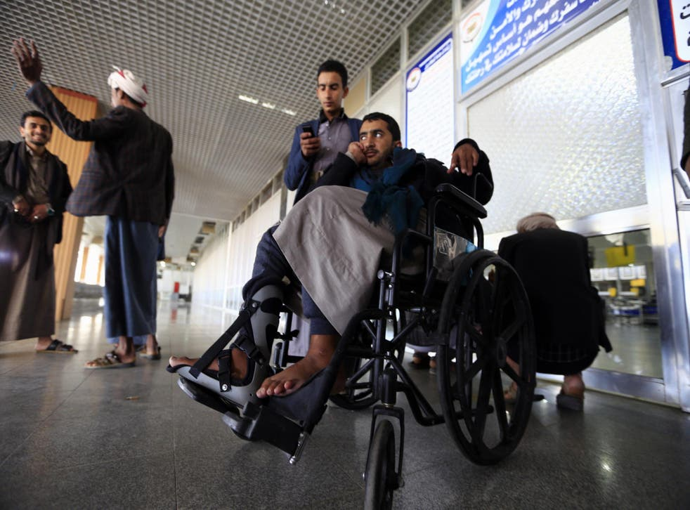 A Houthi fighter waiting to leave Sanaa airport to get treatment in Oman as a condition ahead of UN-brokered peace talks