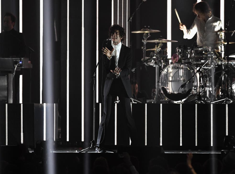 Matthew Healy performs with The 1975 on stage at The BRIT Awards 2017 at The O2 Arena on 22 February, 2017 in London, England.