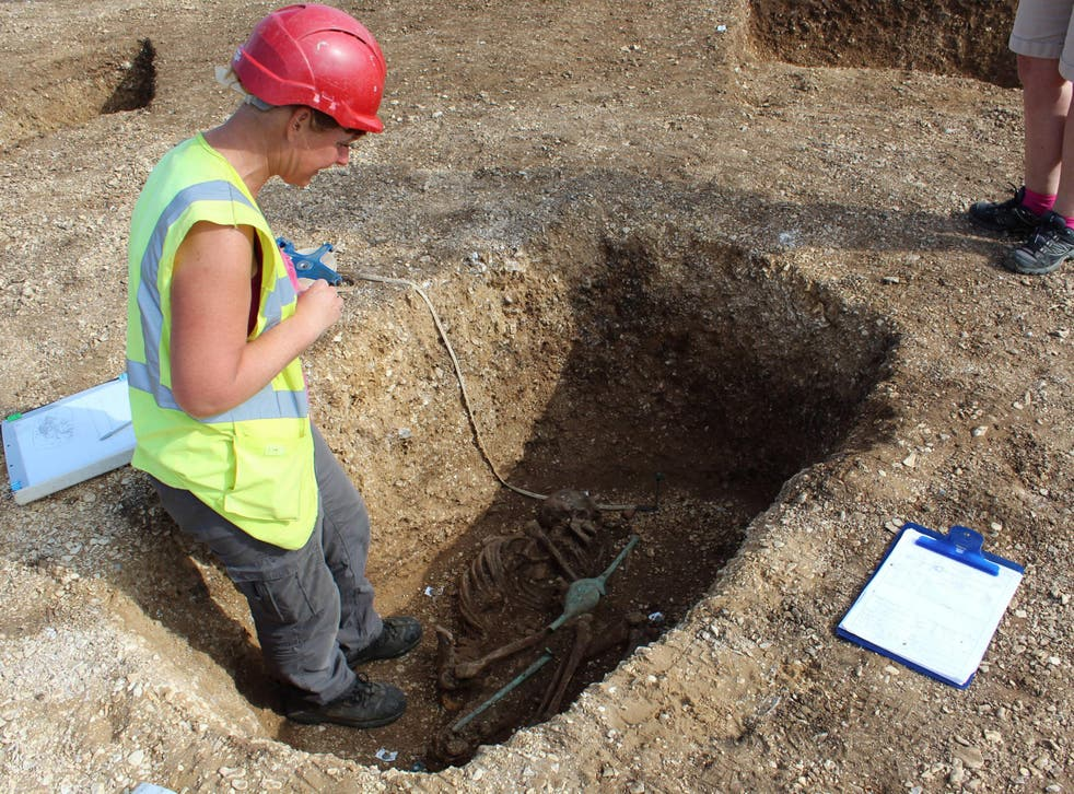 The excavation of the remains of a speared Iron Age man near Pocklington, Yorkshire