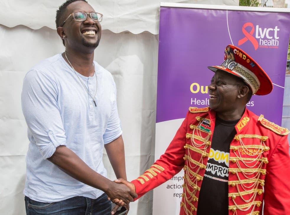 Kenyan pop star Tetu Shani, left, with 'King of Condoms', Stanley Ngara