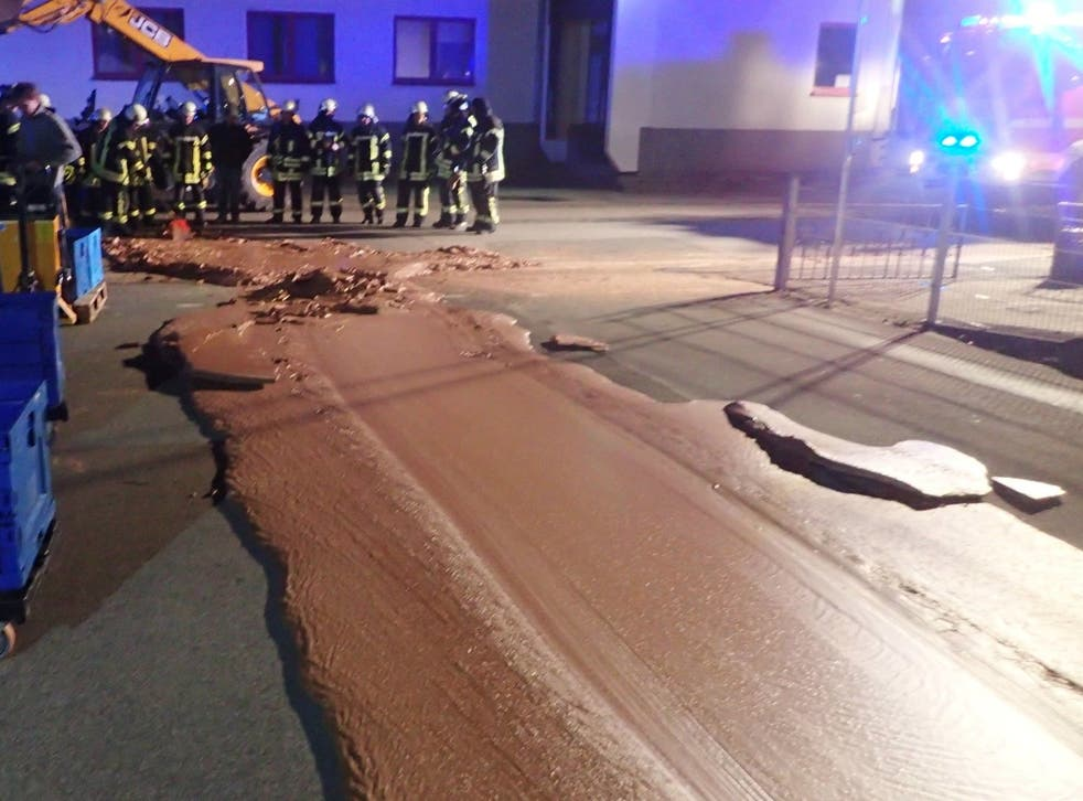 A river of chocolate coats a street in Werl, Germany