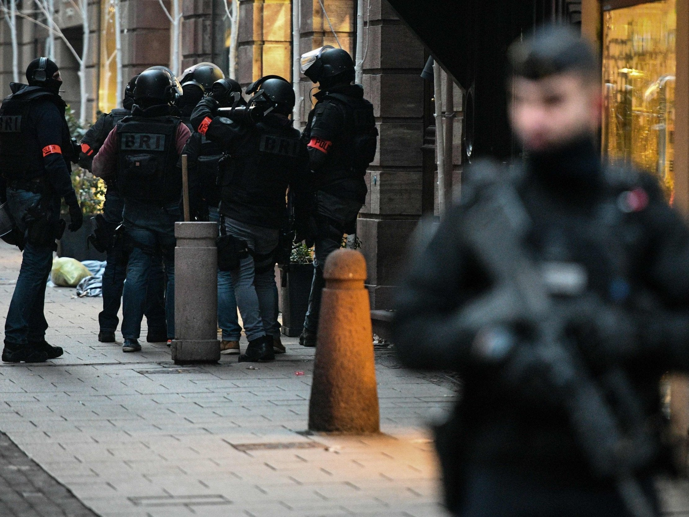Strasbourg manhunt: France raises terror alert level as police search for gunman who killed two at Christmas market