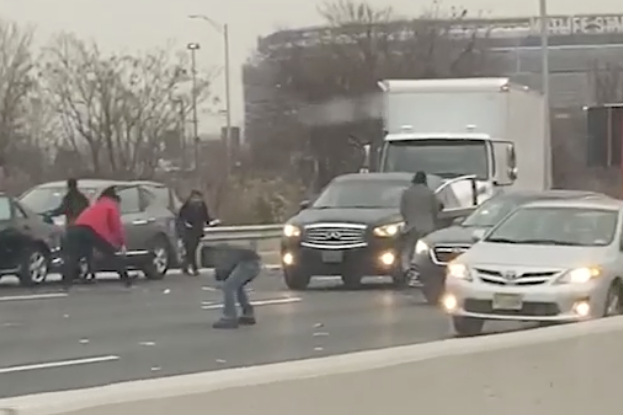 Chaos as money pours onto New Jersey highway after armoured truck