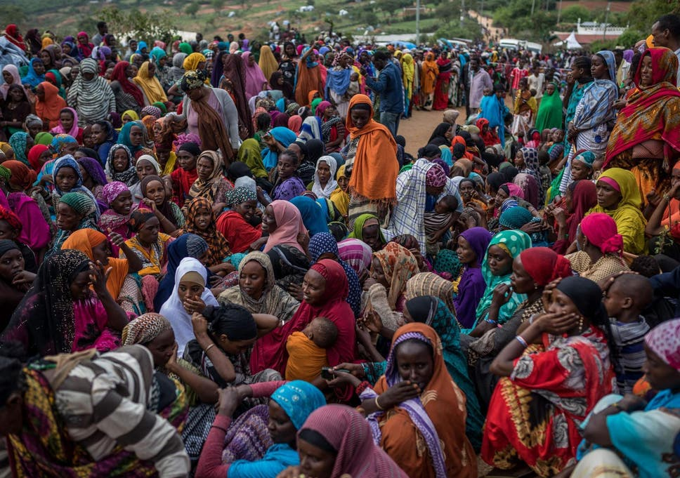 Hundreds of Ethiopians have crossed the border to Kenya. Pictured: women waiting for supplies distributed by Kenyan Red Cross at border town Moyale earlier this year (Brian Otieno/AFP/Getty Images)
