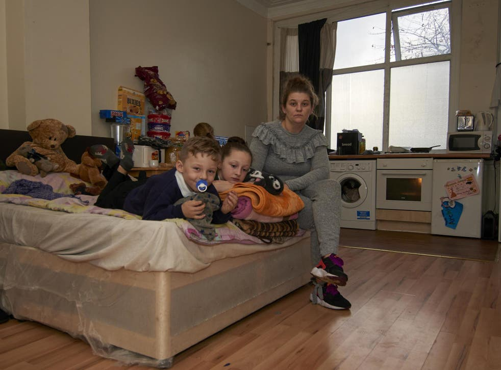 Carly Stutter and her three children share a two-bed room