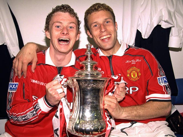 Ole Gunnar Solskjaer and Ronny Johnson celebrate in the dressing room with the FA Cup