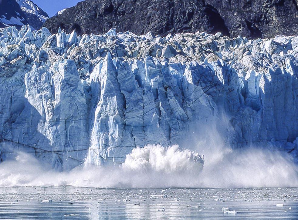 Vanishing act: ice blocks crash into the sea on the Alaskan coast