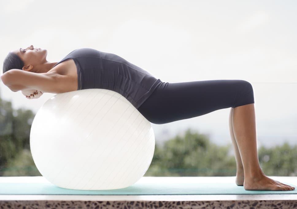 Women stretching mens balls