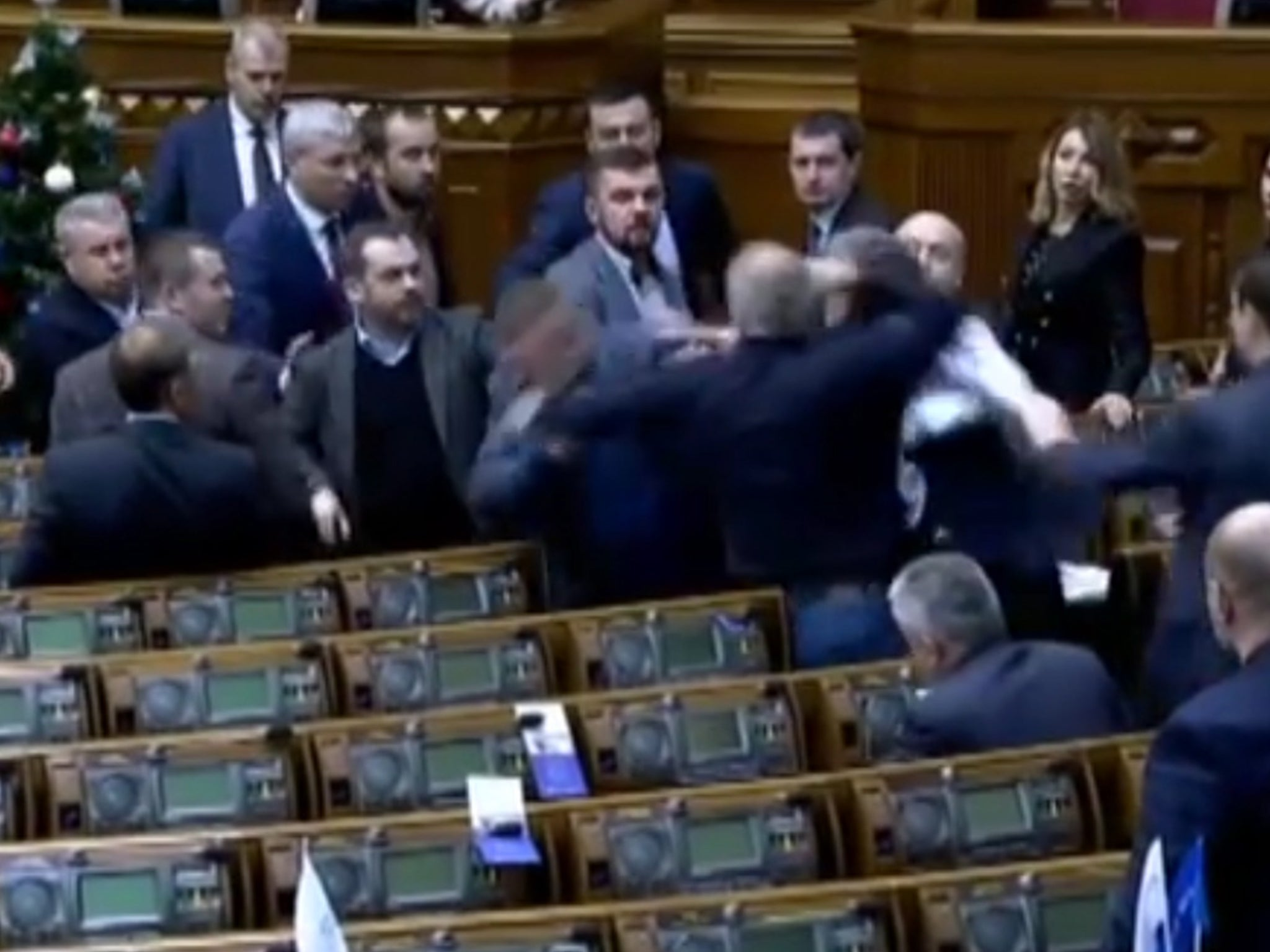 Fight breaks out a Ukrainian parliament over 'Putin's agent' poster