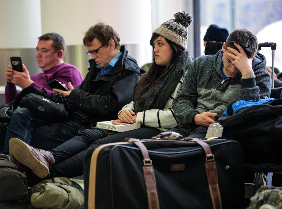 Passengers wait in the South Terminal building at London Gatwick Airport after flights resumed.