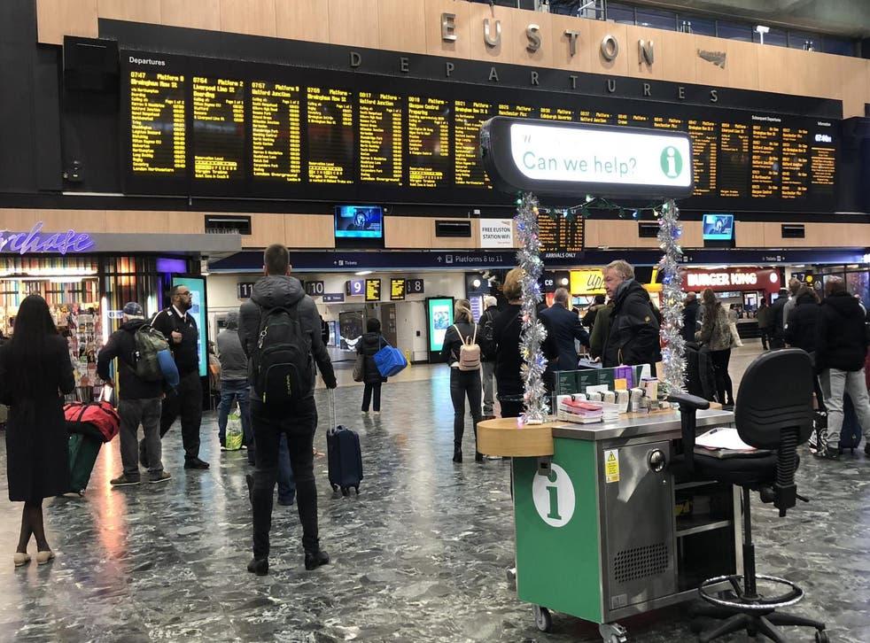 Final call: passengers at London Euston on Christmas Eve