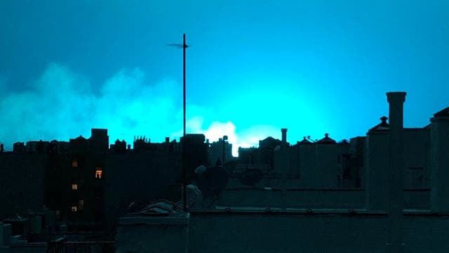 Bright blue light is seen after a transformer explosion on Thursday at an electric power station in the New York City borough of Queens